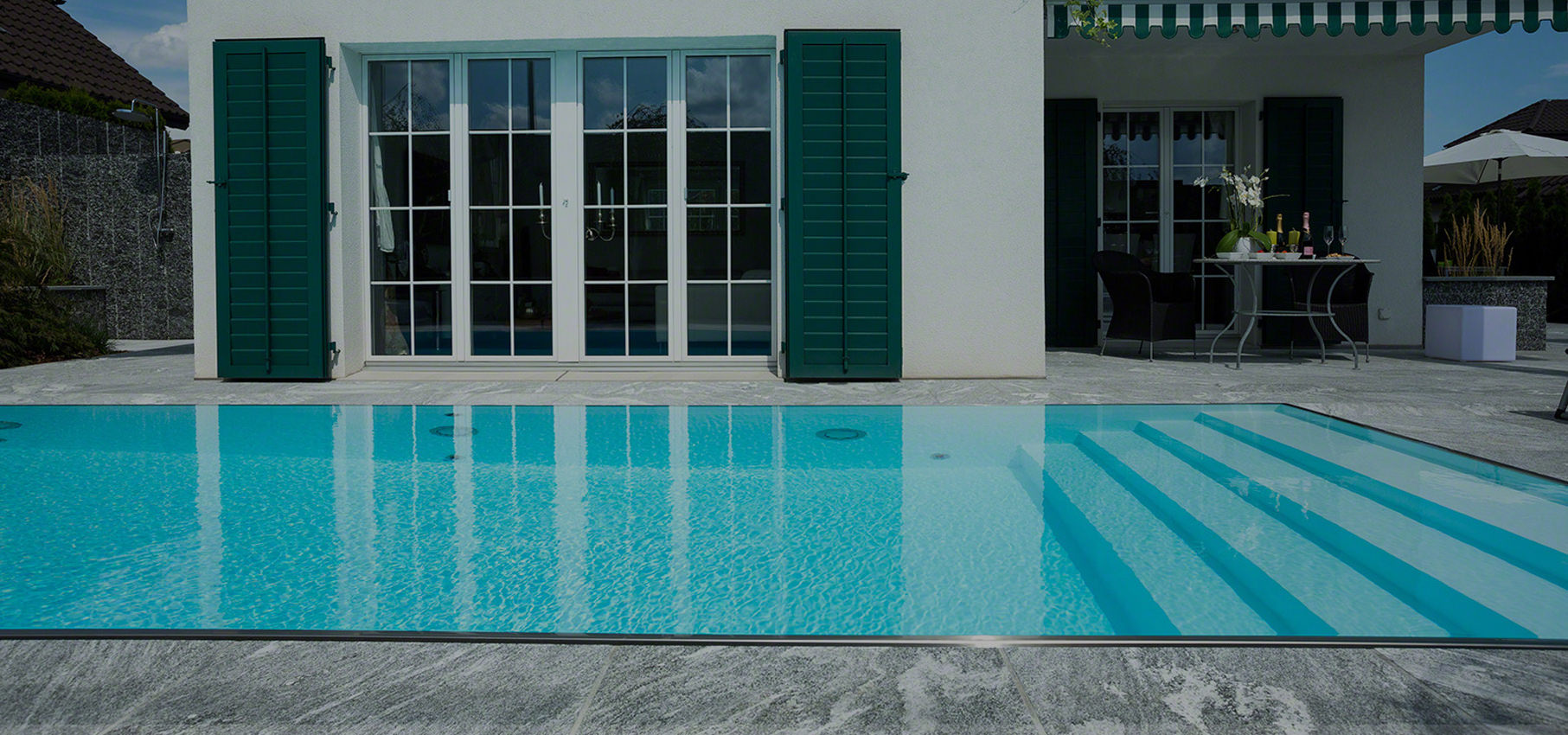 Piscine miroir d bordement designo pool en suisse romande for Installation piscine miroir